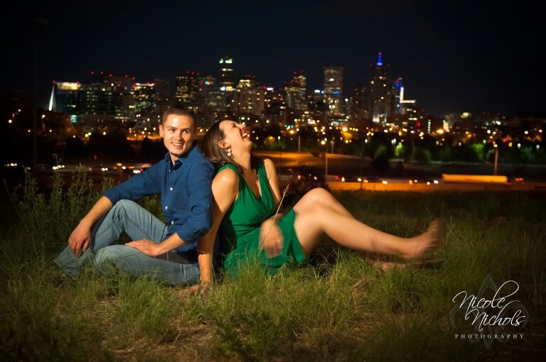 Night engagement pictures with Denver skyline