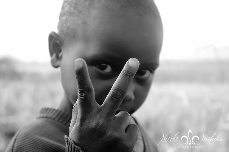 Peace sign by African orphan