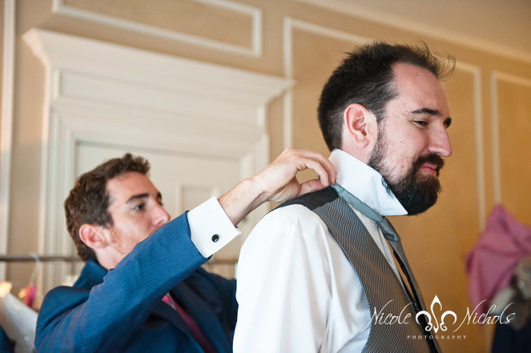 candid picture of groom getting ready at Grant Humphreys Mansion by Denver wedding photographer