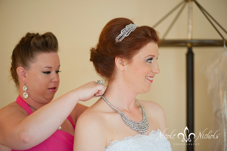 candid picture of bride getting ready at Grant Humphreys Mansion by Denver wedding photographer